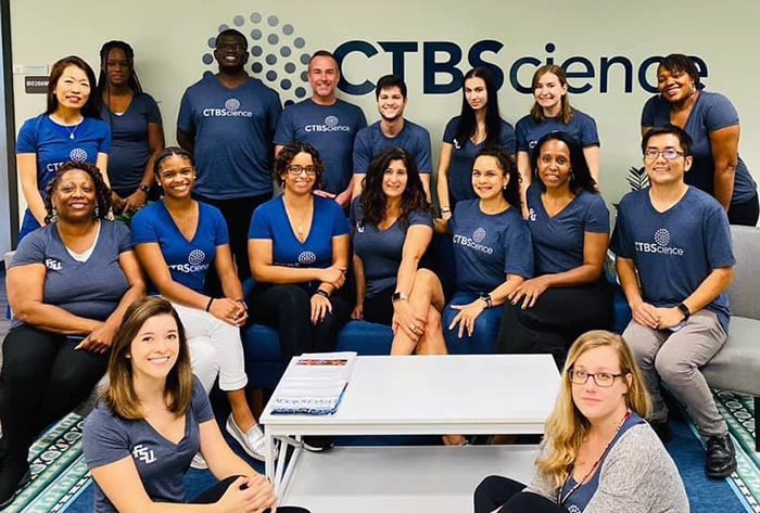 A large group of CTBScience staff members pose for a photo.